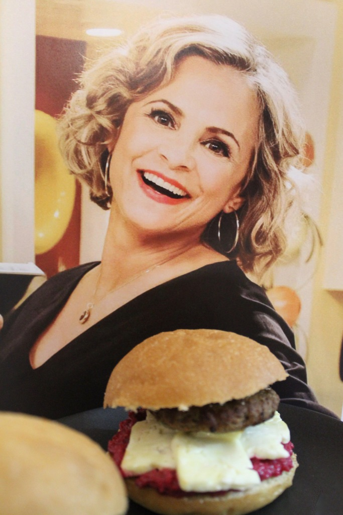 Amy Sedaris preparing to devour a delightful Lamby Slidaris