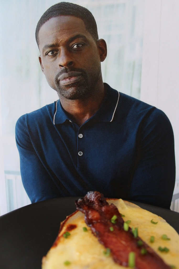 Sterling K. Brown pensively eating a Sterling K. Hot Brown, pondering our beautiful friendship.