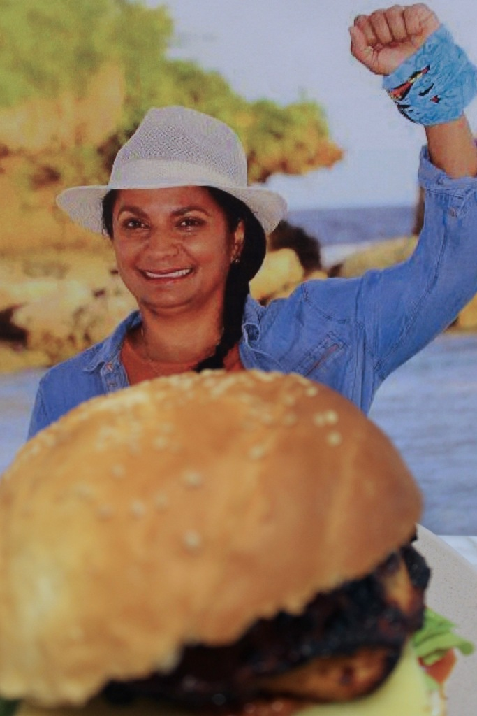 Nova Peris celebrating her fourth boot Nova Peris Peri Chicken Burger.